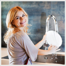 Woman smiling at sink